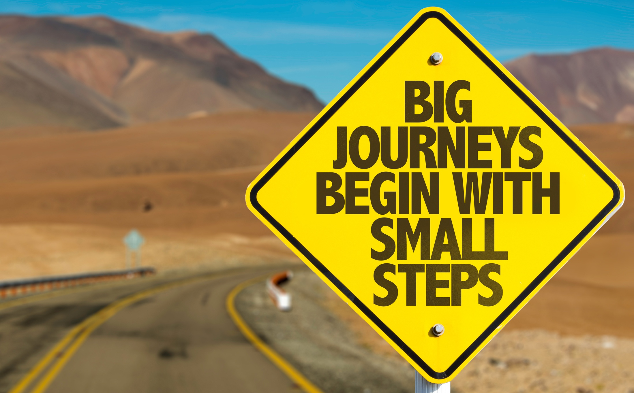 Big Journeys Begin with Small Steps on Sign Post